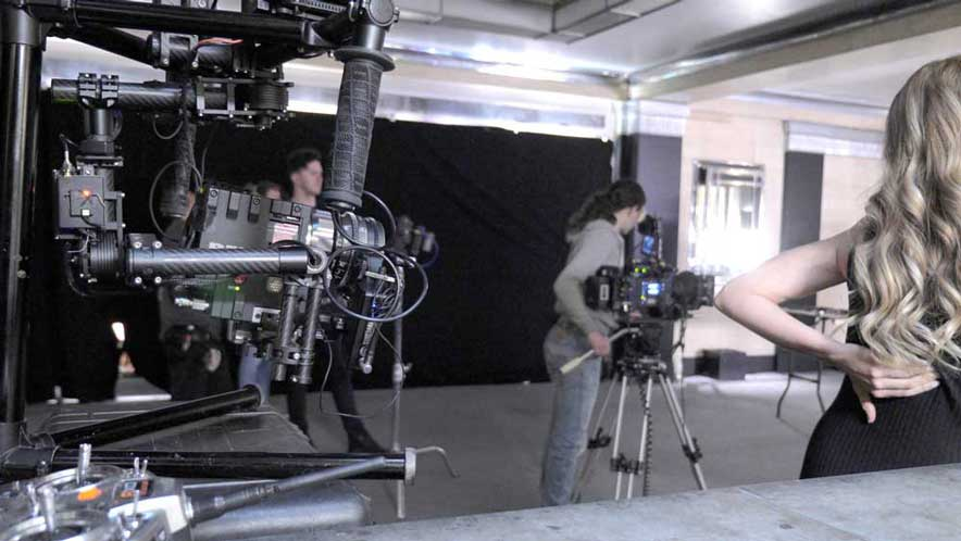 Camera media management Red Epic Dragon on set fitted into a stabiliser rig.