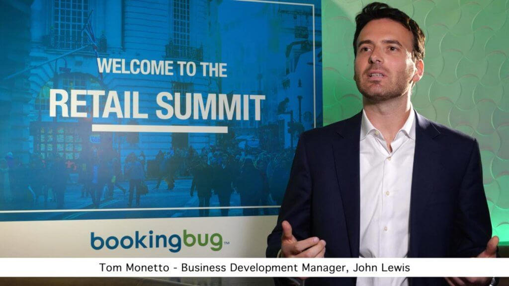 Event videography showing Tom Monetto filmed in front of Booking Bug logo