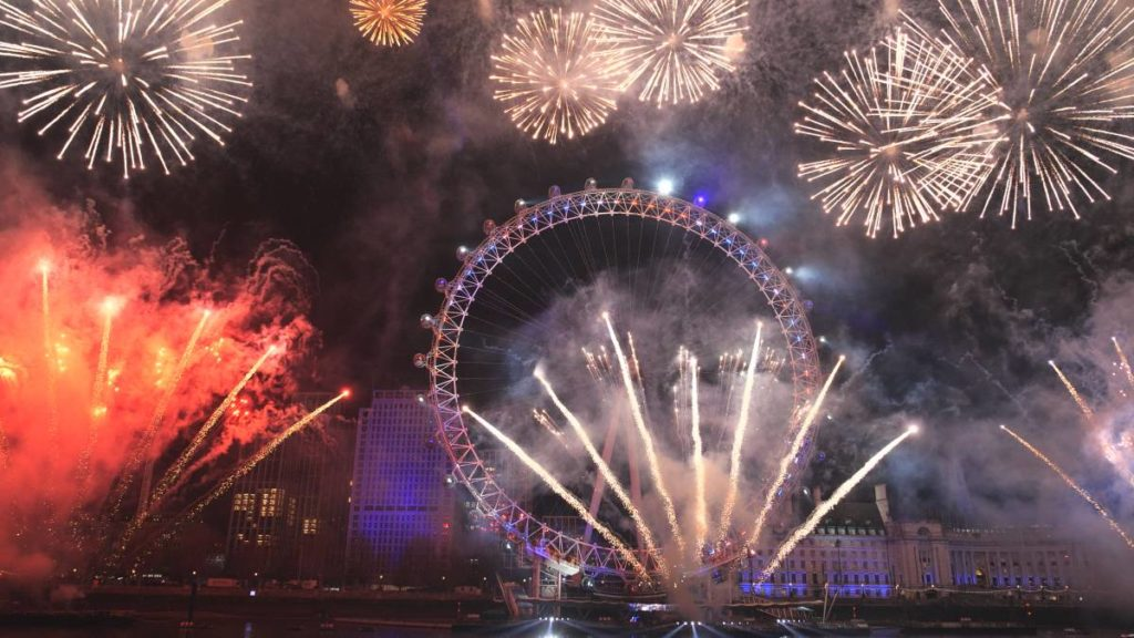 Stock video NYE Midnight London Eye Big Ben sounds GRADED